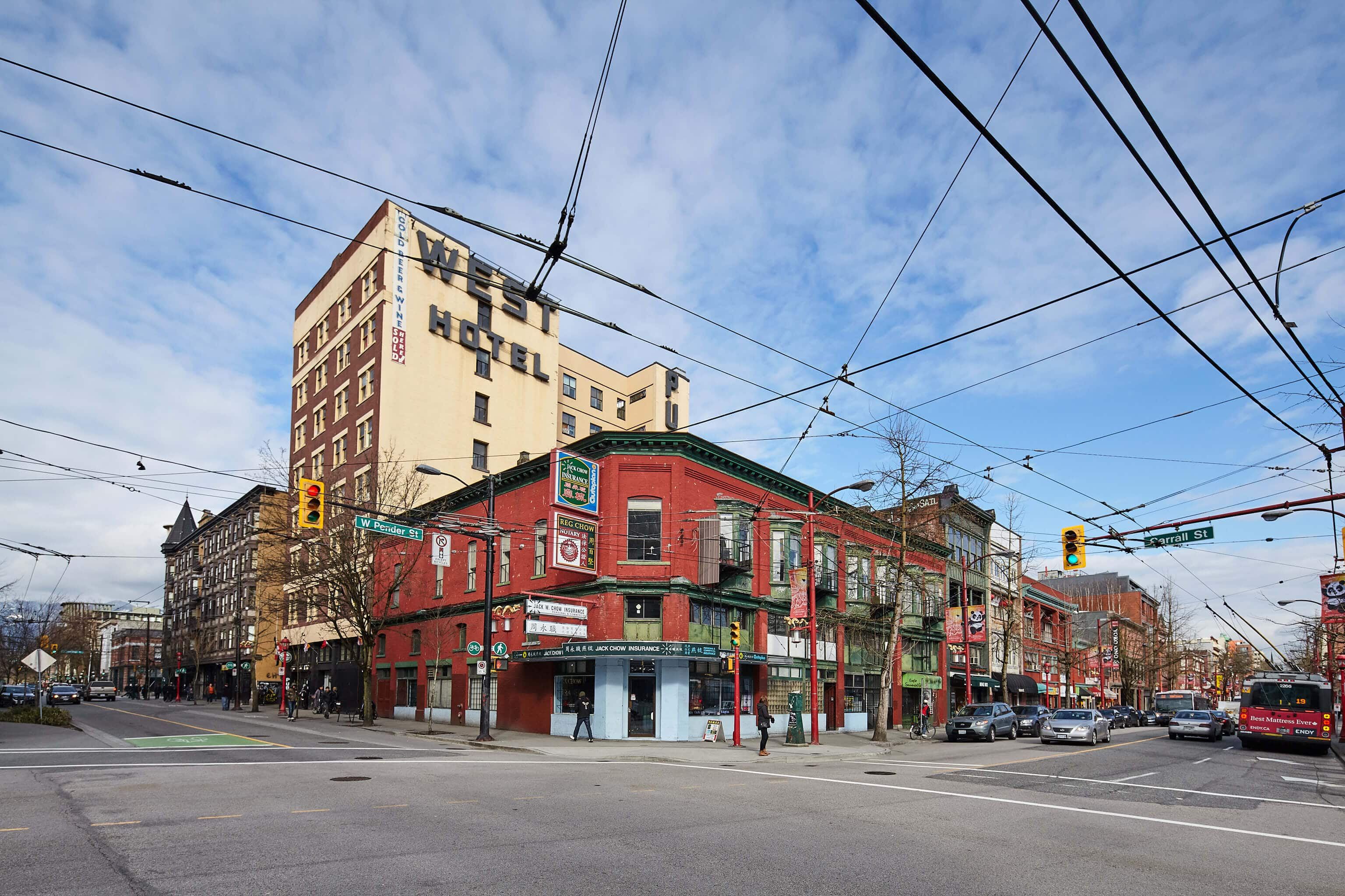 walking past the Strathcona Historic District shops