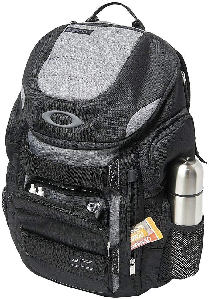 photo of the enduro 2.0 backpack holding accessories